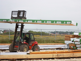 Forklift moving wood to make trusses - Truss Fab Inc. -  Elie Manitoba